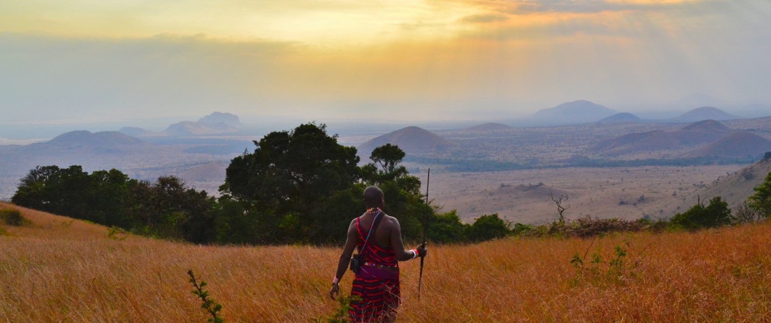 Masai looking over the vast Serengeti plains